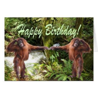 Bebés del orangután en tarjeta de cumpleaños de la