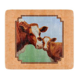 Becerro de Guernesey y melocotón de la vaca de la Tabla De Cortar