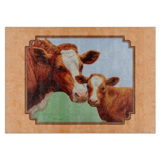 Becerro de Guernesey y melocotón de la vaca de la Tablas De Cortar