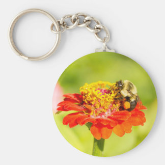 bee on red flower with pollen sacs keychain