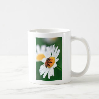 Bee pollinating flower coffee mug