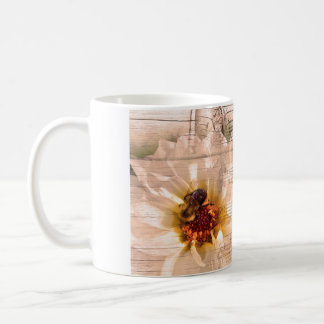 Bee with flower and musical notes collage. coffee mug
