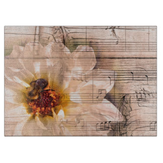 Bee with flower and musical notes collage. cutting board