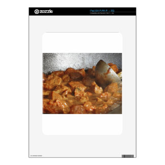 Beef goulash soup with metal serving spoon iPad skins