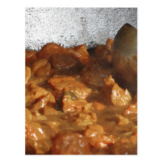 Beef goulash soup with metal serving spoon postcard