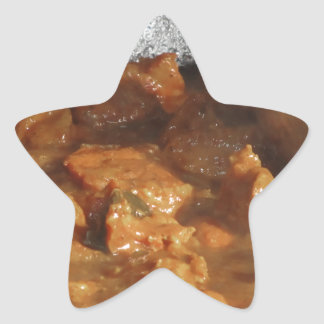 Beef goulash soup with metal serving spoon star sticker