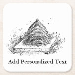 """Beehive Black and White Vintage Drawing Square Paper Coaster<br><div class=""""desc"""">This is  a vintage black and white illustration of a beehive. Personalize or remove text.</div>"""