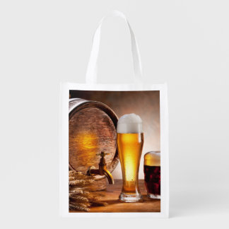 Beer barrel with beer glasses on a wooden table 2 grocery bag