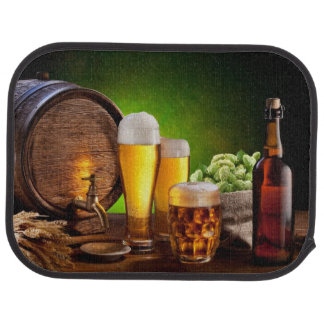 Beer barrel with beer glasses on a wooden table car mat