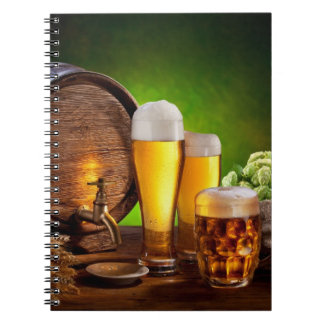 Beer barrel with beer glasses on a wooden table notebook
