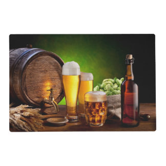 Beer barrel with beer glasses on a wooden table placemat