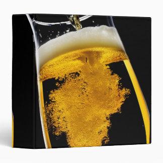 Beer been poured into glass vinyl binders