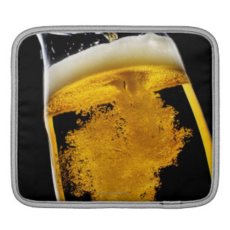 Beer been poured into glass iPad sleeve