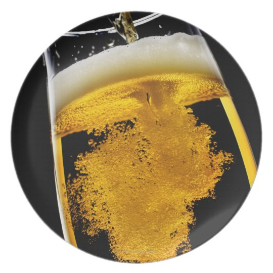 Beer been poured into glass plate
