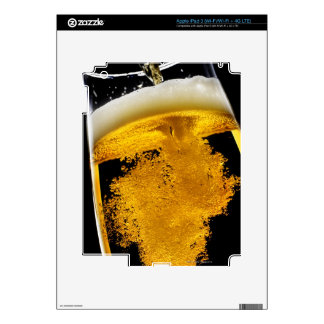 Beer been poured into glass skin for iPad 3