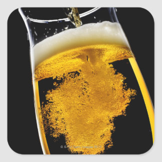 Beer been poured into glass square sticker