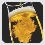 Beer been poured into glass, studio shot stickers