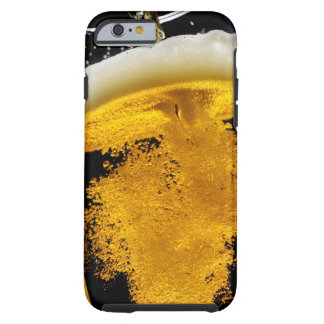 Beer been poured into glass, studio shot tough iPhone 6 case