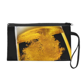 Beer been poured into glass wristlet purse