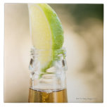 Beer bottle with lime wedge ceramic tile