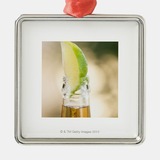 Beer bottle with lime wedge square metal christmas ornament