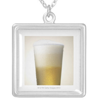 beer with foamy head silver plated necklace