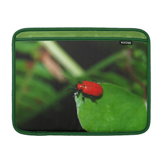 Beetle of shining red color in the leaf MacBook sleeve