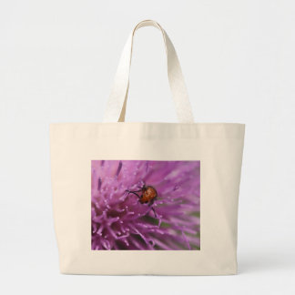 Beetle on a Milk Thistle Canvas Bags