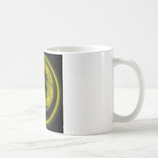 behind a blue eye coffee mug