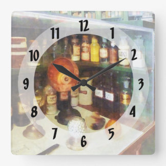 Behind the Counter at the Drugstore Square Wallclock