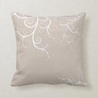 Beige pillow with fancy white swirls illustration