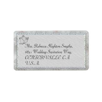 Belces de plata que casan etiquetas de dirección