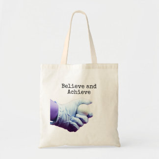 Believe and Achieve with hand is holding golf ball Tote Bag