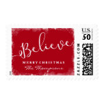 Believe in Christmas Rustic Snow Merry Red Postage<br><div class='desc'>Show that you &quot;Believe&quot; in the magic of the Holidays with this rustic holiday postage stamp. The word &quot;Believe&quot; is angled across the front and your custom greeting and name are framed by a snowy border and Christmas red background (change the color by clicking on the &quot;customize it&quot; button and...</div>