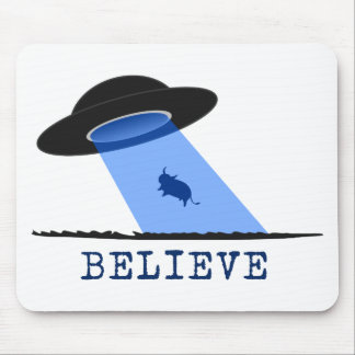Believe (UFO beaming up cow) Mouse Pads