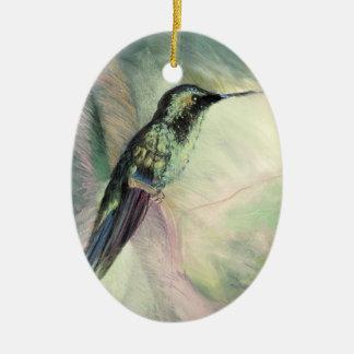 Bella arte del pastel del colibrí adorno navideño ovalado de cerámica