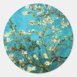 Bella arte floreciente del árbol de almendra de pegatinas redondas