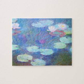 Bella arte rosada de Monet de los lirios de agua Puzzles