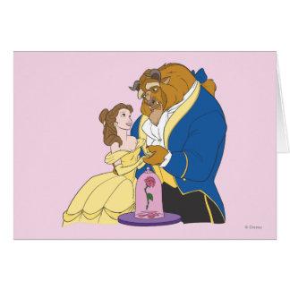 Belleza y bestia que llevan a cabo las manos tarjeta de felicitación
