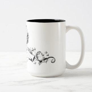 Belleza y la taza del logotipo de la bestia