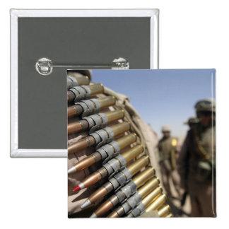 Belts of 50-caliber ammunition button
