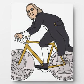 Ben Franklin On A Bike With Half Dollar Wheels Plaque