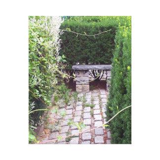 Bench and Cobblestone Garden Path Canvas Print