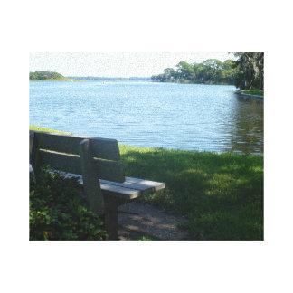 Bench by lake. canvas print