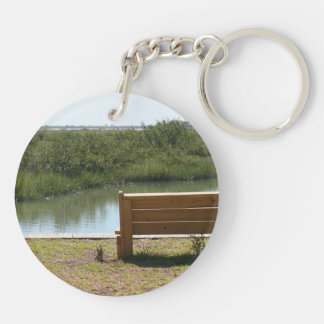 Bench by river with grass and water Double-Sided round acrylic keychain