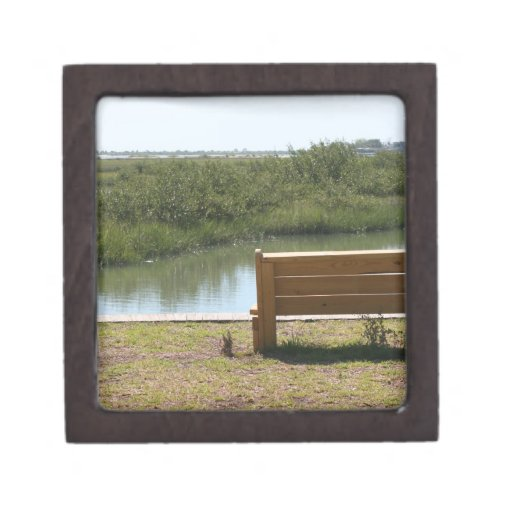 Bench by river with grass and water premium jewelry boxes