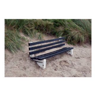 bench covered in sand poster