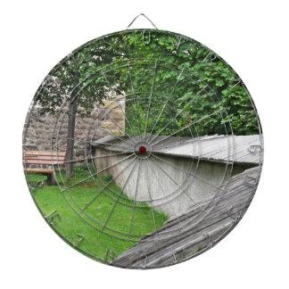 Bench in a meadow dart board