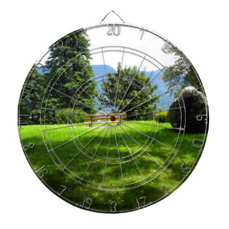 Bench in a meadow with stone dart boards