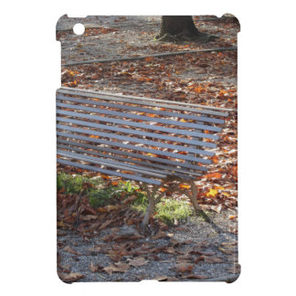 Bench in autumn park with dead leaves iPad mini cover